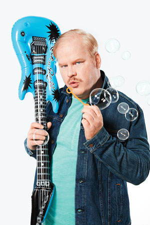 Jim Gaffigan with guitar