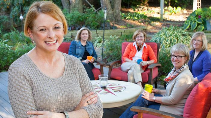 Karol Nickell with friends in her backyard