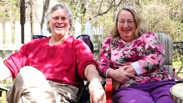 Denis and Patty outside their home