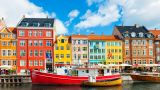 Famous Nyhavn pier with colorful buildings and boats in Copenhagen, Denmark