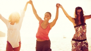 Three happy woman at the beach