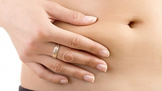 Woman squeezing her stomach