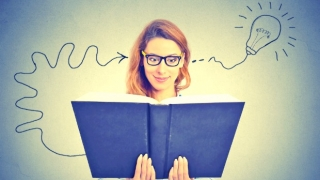 Woman with open book, her head filling with amazing ideas.
