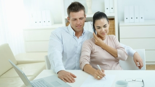 Happy Couple paying bills