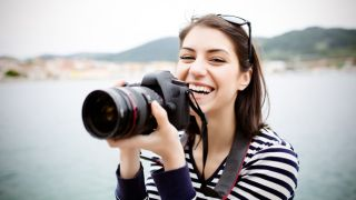 Woman holding a camera.