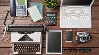 Desk with old and new technology.