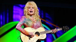Dolly Parton playing guitar