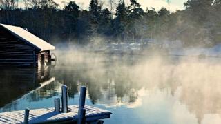 Log cabin on beautiful lake.