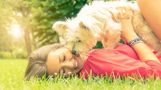 Woman canoodling with her dog.