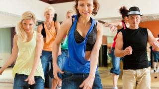 Women and men in a fun dance class
