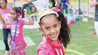 Birthday girl doing hula-hoop.