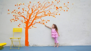 Girl reaching for tree