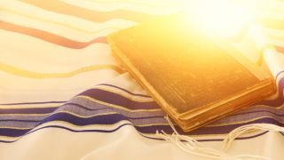 Jewish prayer book and talit.