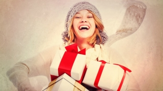 Smiling woman with holiday presents.