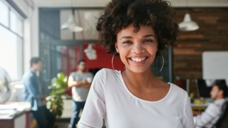 Smiling woman who is happy at work