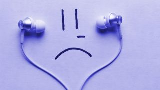 Purple sad face listening to earbuds.