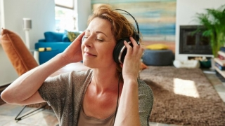 Woman listening to music on her headphones.