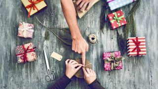 People wrapping holiday gifts