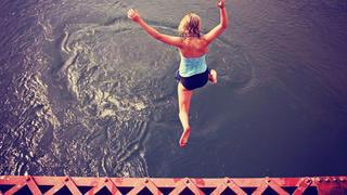 Woman jumping off a bridge