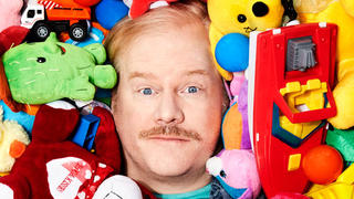 Jim Gaffigan buried in toys