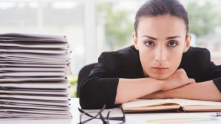 Stressed-looking woman at work