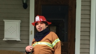 Max dressed as a fireman