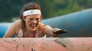 Woman participating in a mud run.