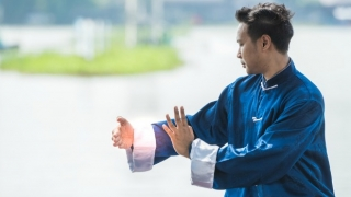 Man practicing qi gong outdoors.