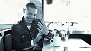 Actor Theo Rossi in a diner.