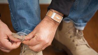 Man wearing a WellBe bracelet.