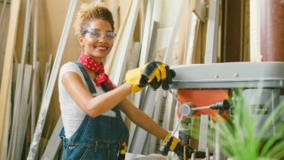 Confident woman working with a table saw.