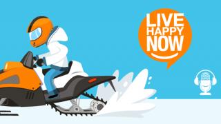 A person riding a snow mobile