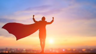 A woman with a superhero cape ready to take on the world.