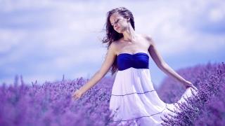Happy woman in sunny lavender field.