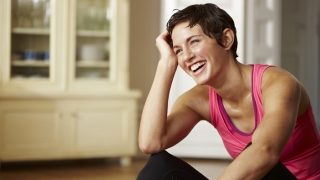 Happy woman in pink workout top.