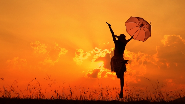 Umbrella woman jump and sunset silhouette