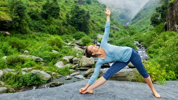 Woman doing triangle pose in yoga.