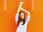 Woman standing in front of orange wall