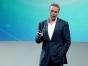 Dan Buettner speaking on stage.