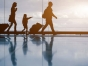 Family with luggage walking at airport