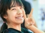 Young Asian woman giving the peace sign.