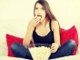 Woman eating popcorn and watching a movie