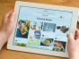 Image of hands holding an iPad with Pinterest displayed