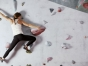 Woman scaling a climbing wall
