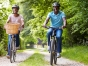 Happy people riding bikes on a path