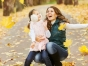 Mom and child in falling leaves
