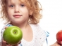 Girl offering to share her apple