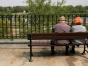 Two people sitting on a bench