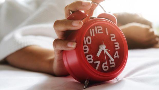Waking up to alarm clock.