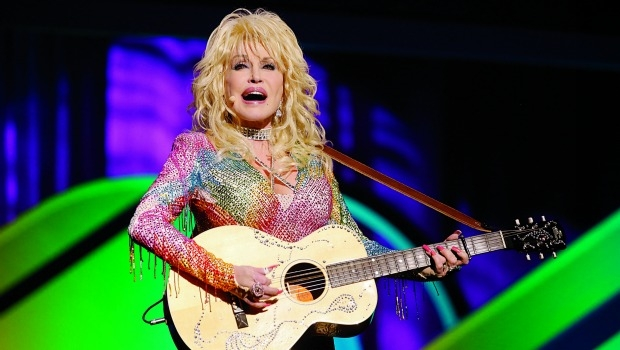 Dolly Parton playing guitar onstage
